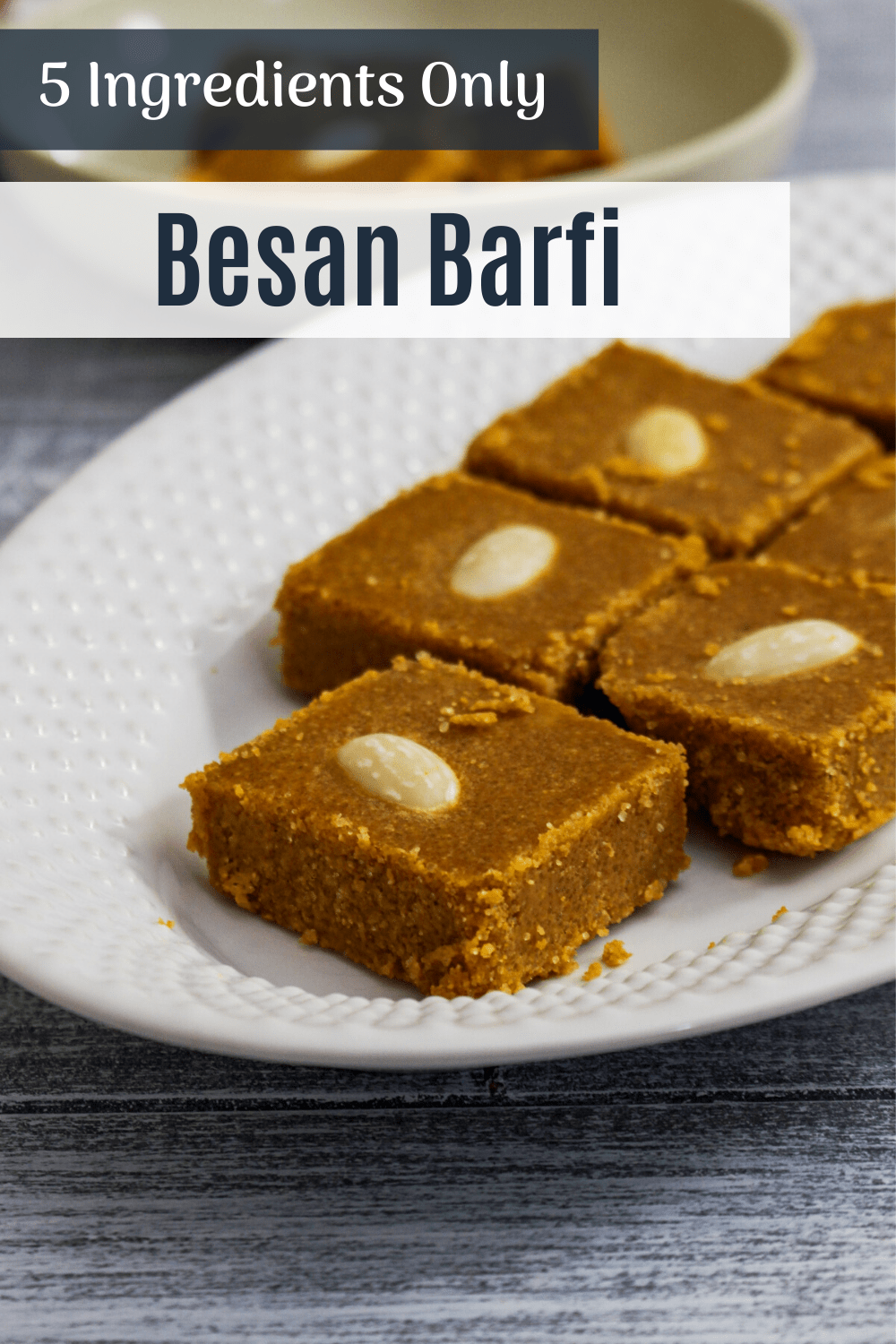 besan barfi pieces in a plate with text on top.