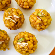 Close up shot of boondi ladoo garnished with chopped nuts