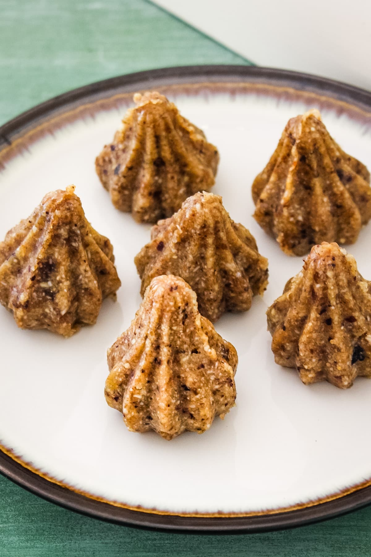 Close up image of dry fruits modak arranged on a plate