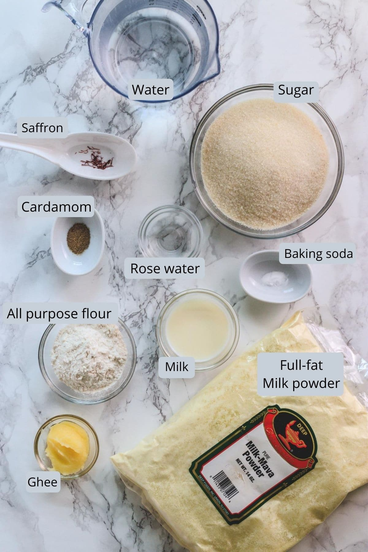 ingredients used in gulab jamun inclues milk powder, ghee, flour, baking soda, cardamom, saffron, sugar, water, rose water.