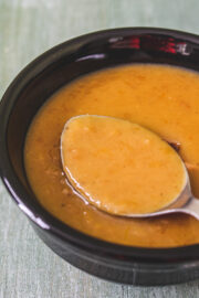 Moong dal kheer taken from a bowl using a spoon ready to eat