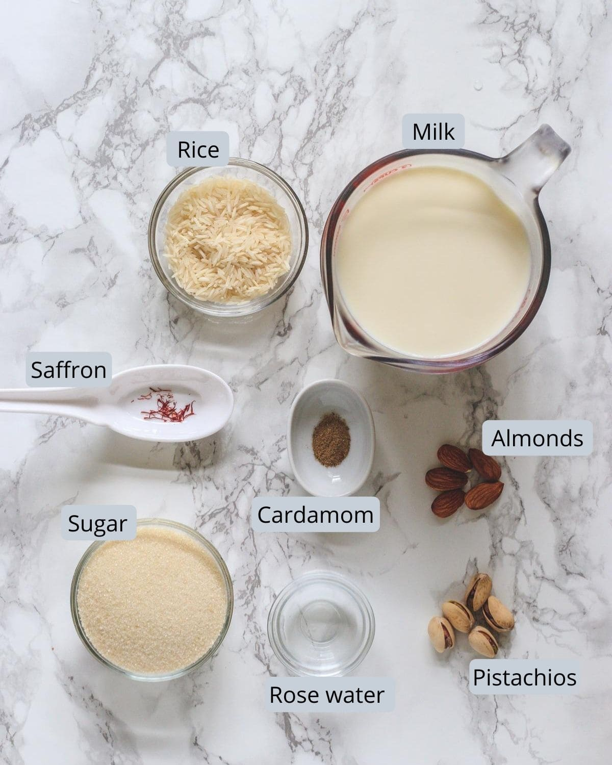 ingredients used in phirni includes milk, rice, sugar, cardamom, saffron, rose water, almonds, pistachios