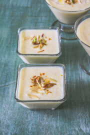 phirni in individual serving bowl garnish with sliced nuts and saffron.