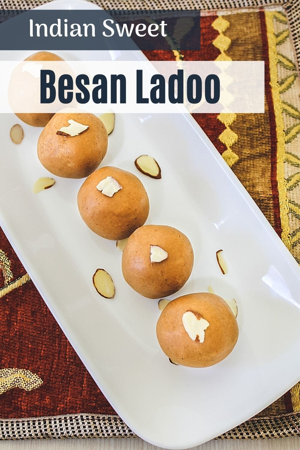 besan ladoo garnish with almonds on a plate with text on top of image