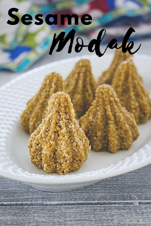 5 sesame seeds modak in an oval plate with text 'sesame modak' for piterest