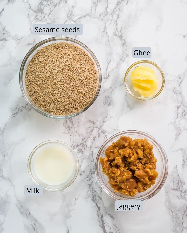 image of ingredients used in til modak. Includes sesame seeds, ghee, jaggery, milk.