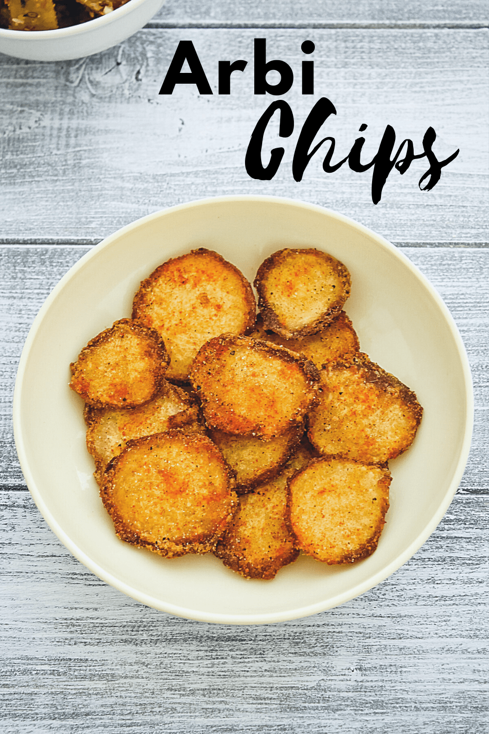 arbi chips in a plate with text on the image for pinterest