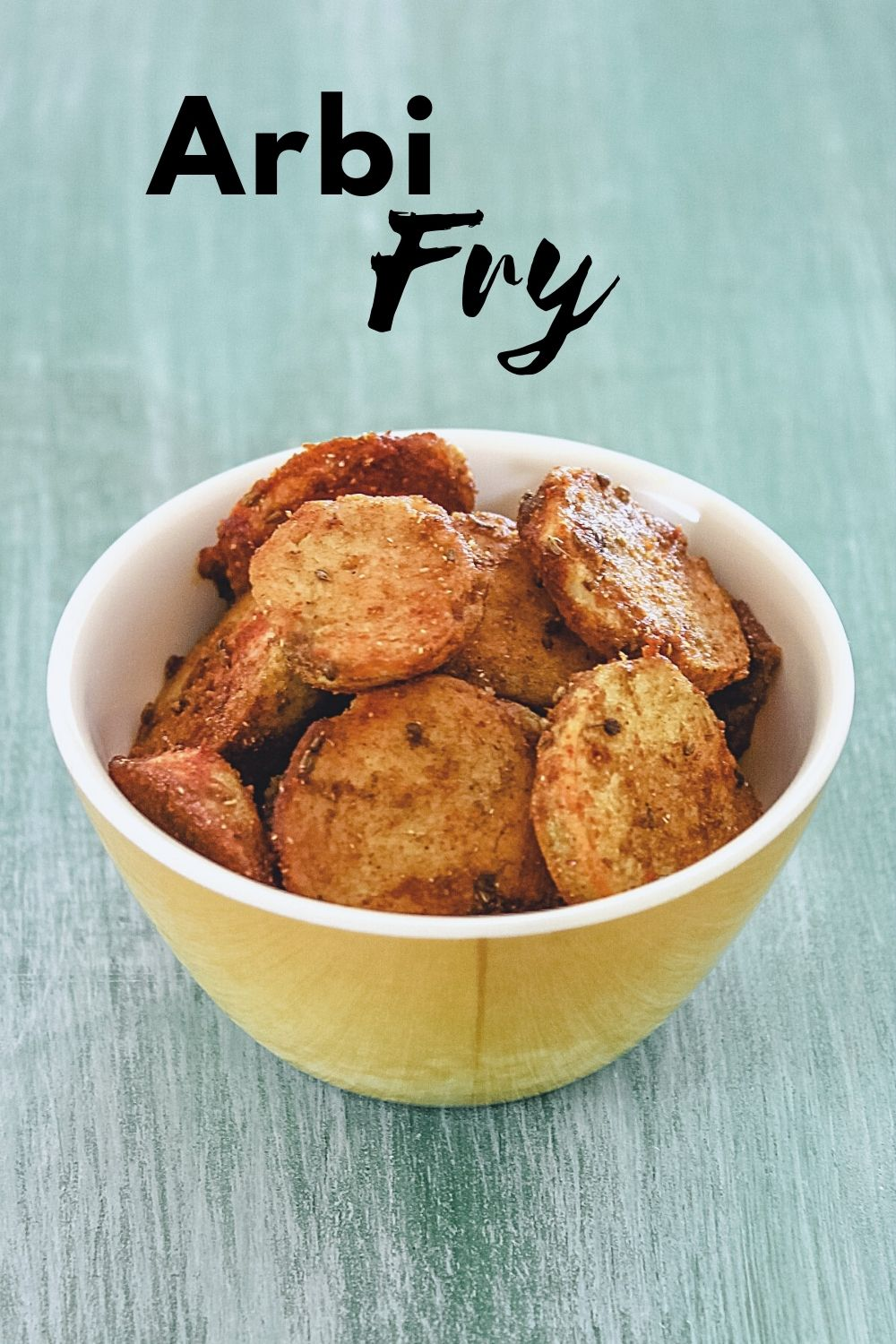 Arbi fry in a bowl with text on the image for pinterest