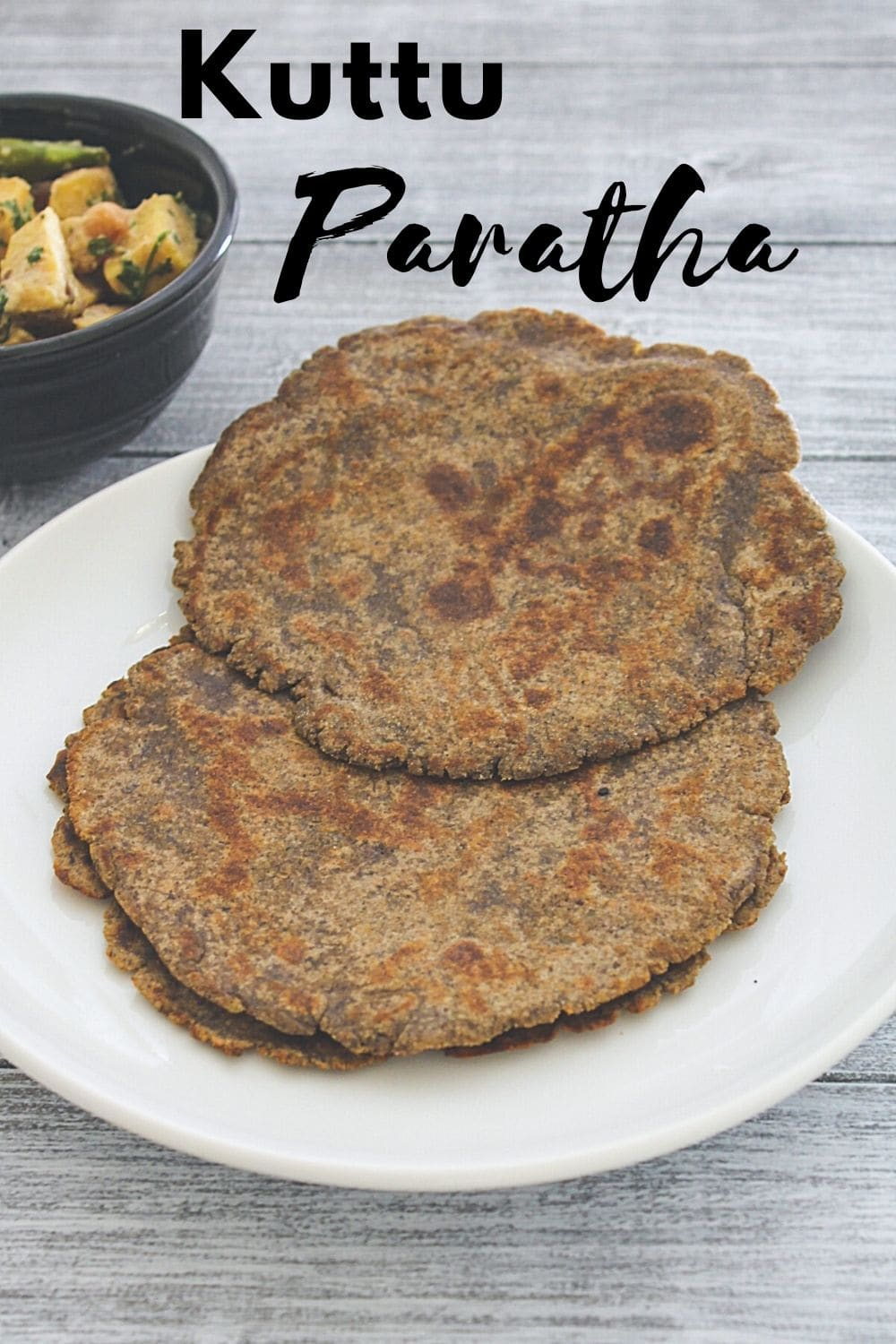 kuttu paratha in a plate with text on the image for pinterest.