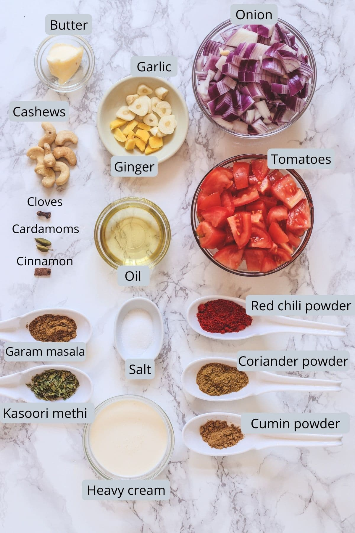 Ingredients used in the gravy includes onion, tomato, ginger, garlic, whole spices, cashews, oil, butter, salt, spice powders and cream
