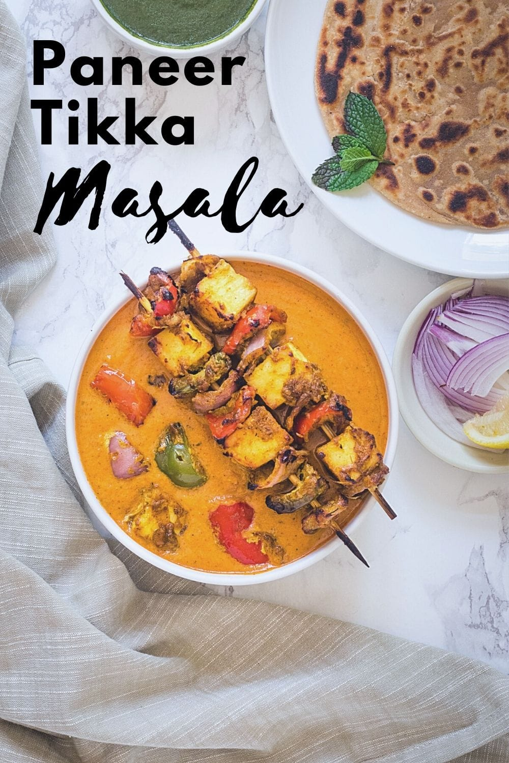 paneer tikka masala in a bowl with text on the image for pinterest