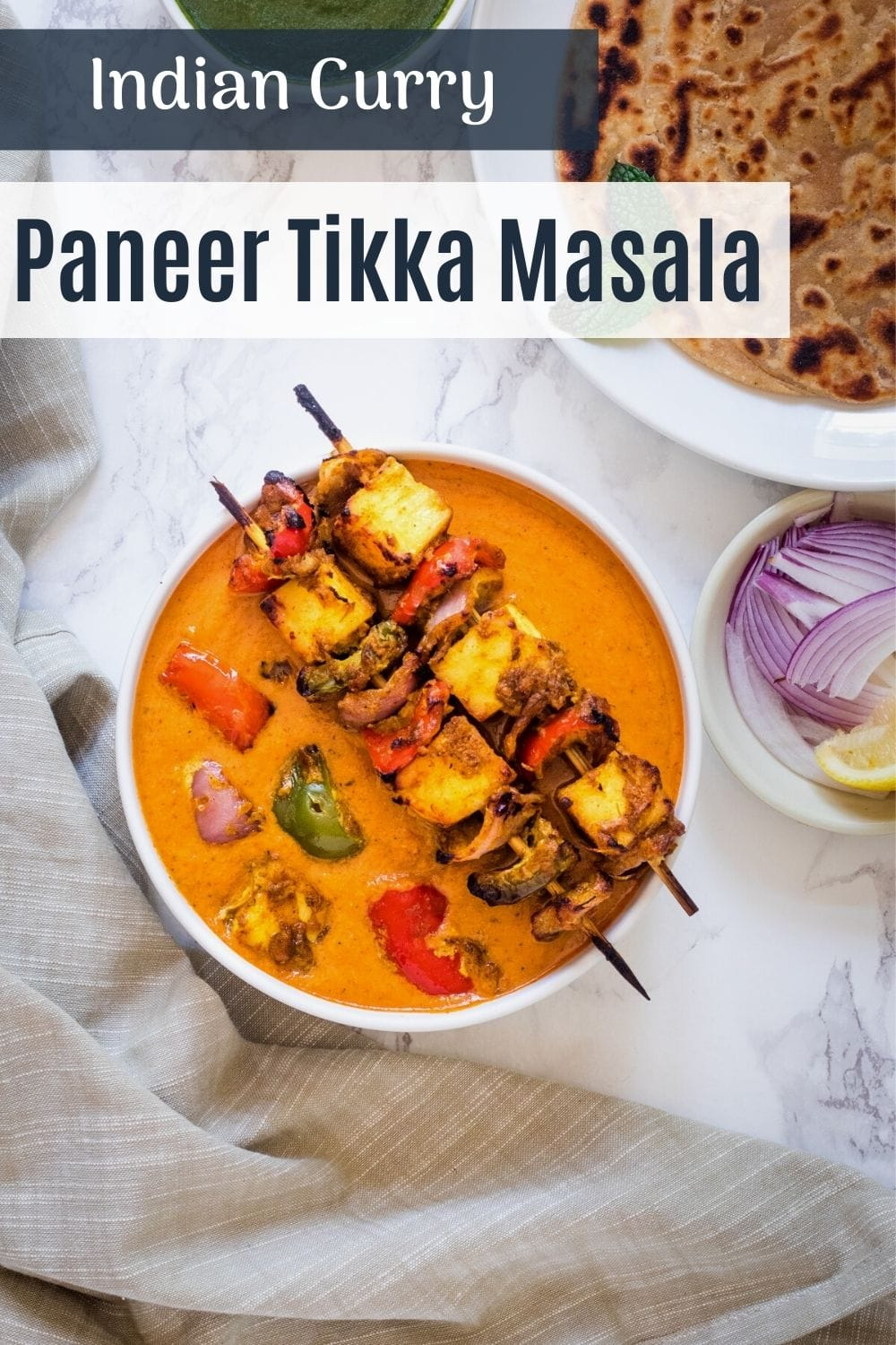 top view of paneer tikka masala with text on the image for pinterest