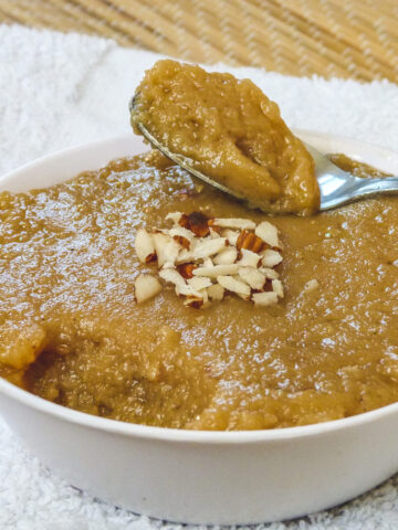 a spoon full ora rajgira halwa taken from the bowl and ready to eat
