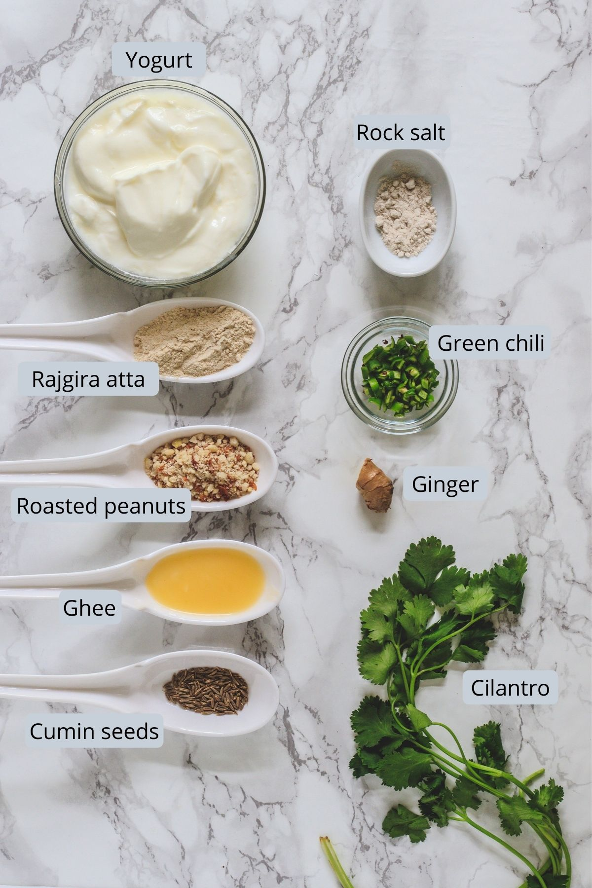 ingredients used in rajgira kadhi includes yogurt, rajgira flour, rock salt, ghee, cumin seeds, peanuts, cilantro, ginger, green chili