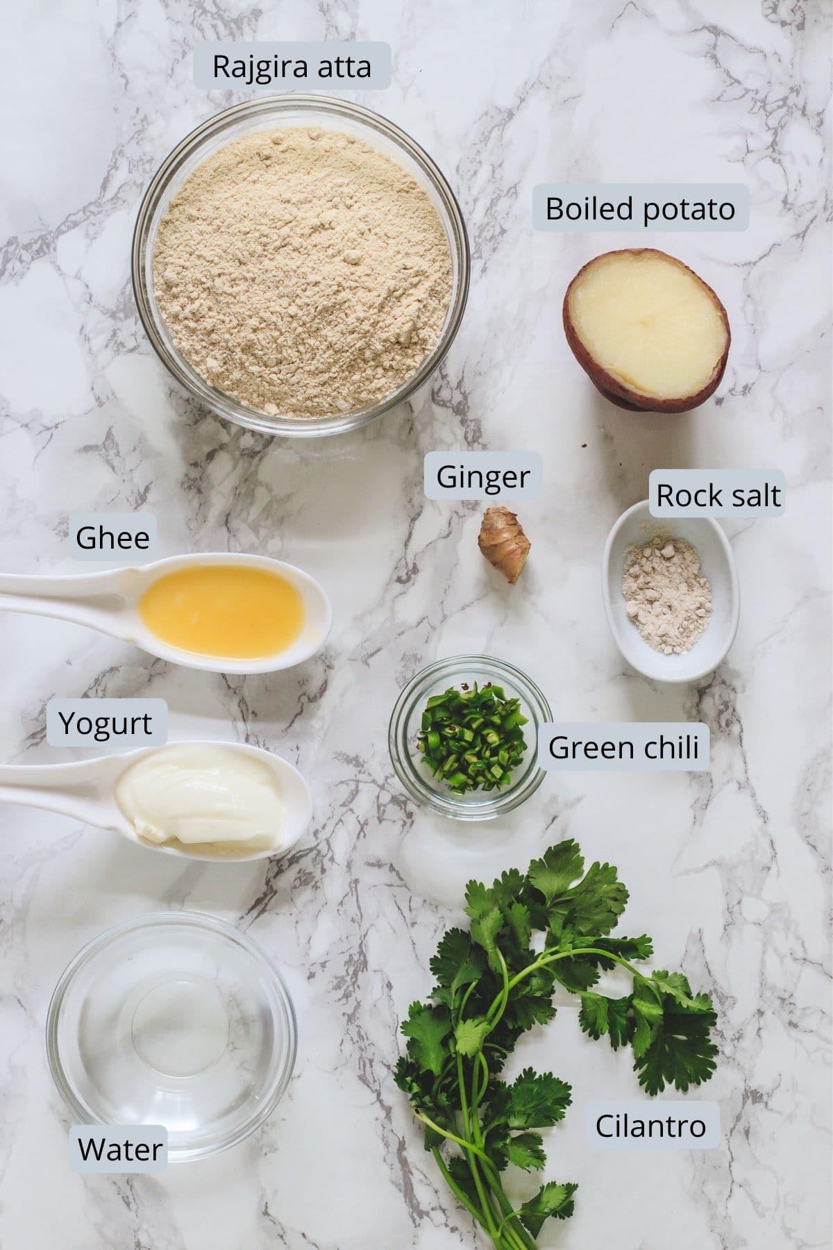 Ingredients used in rajgira paratha includes amaranth flour, boiled potato, ghee, yogurt, rock salt, ginger, green chili, cilantro and water.