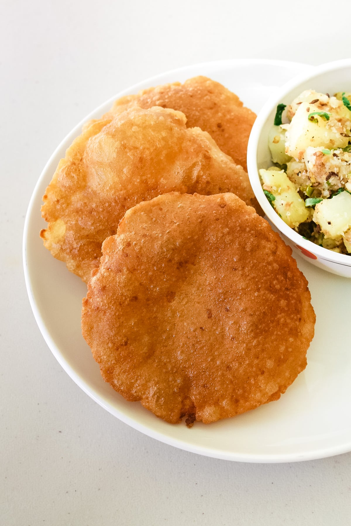 Rajgira puri in a plate with side of sukhi bhaji