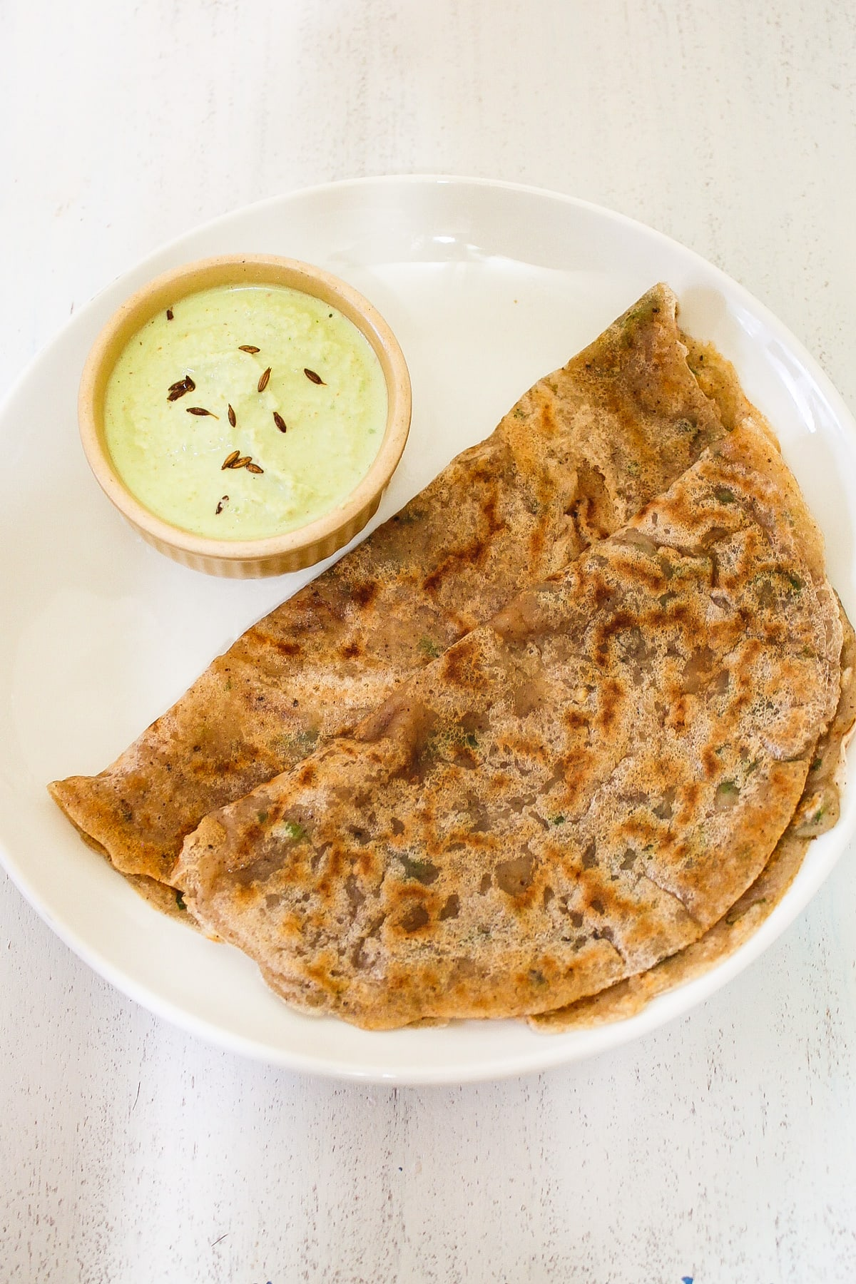 farali dosa in a plate served with coconut chutney