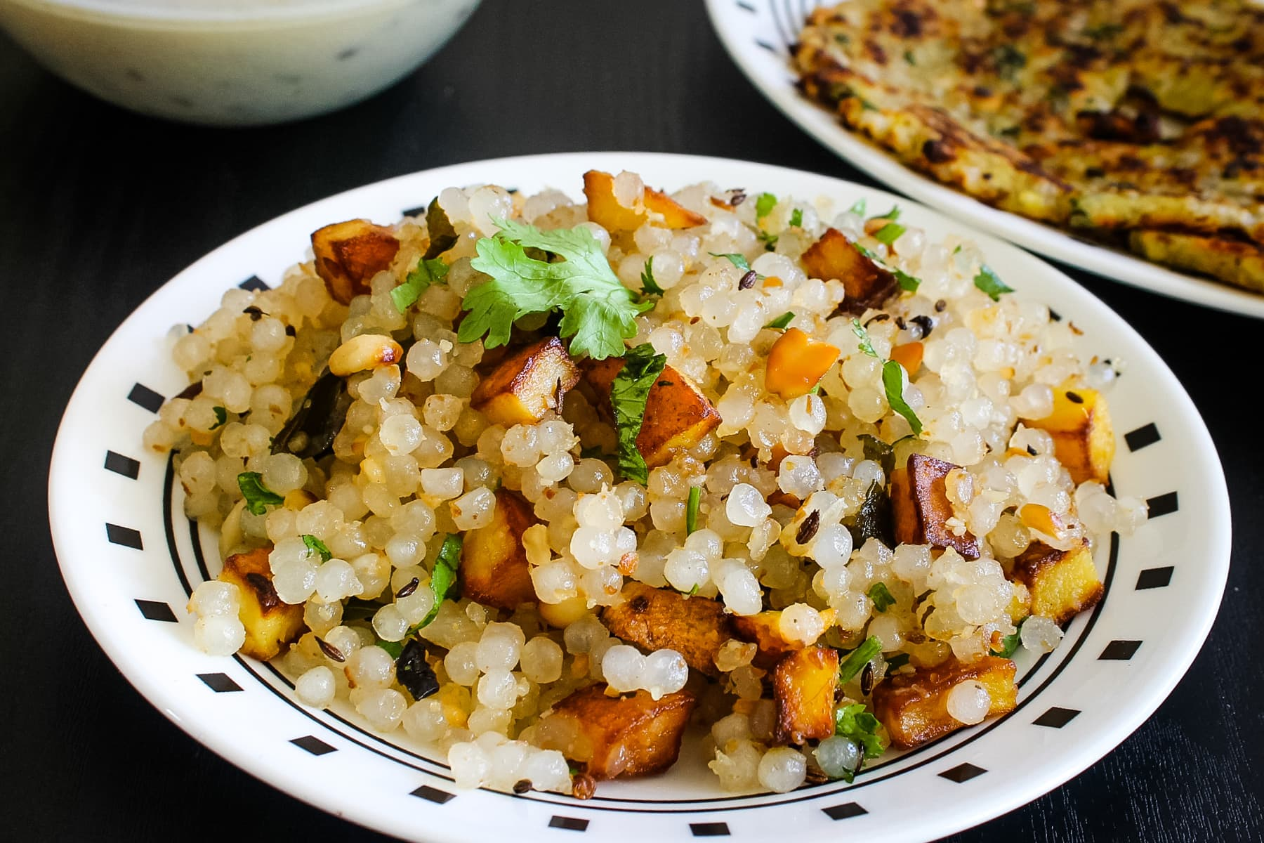 Sabudana khichdi in a plate with a garnish of cilantro