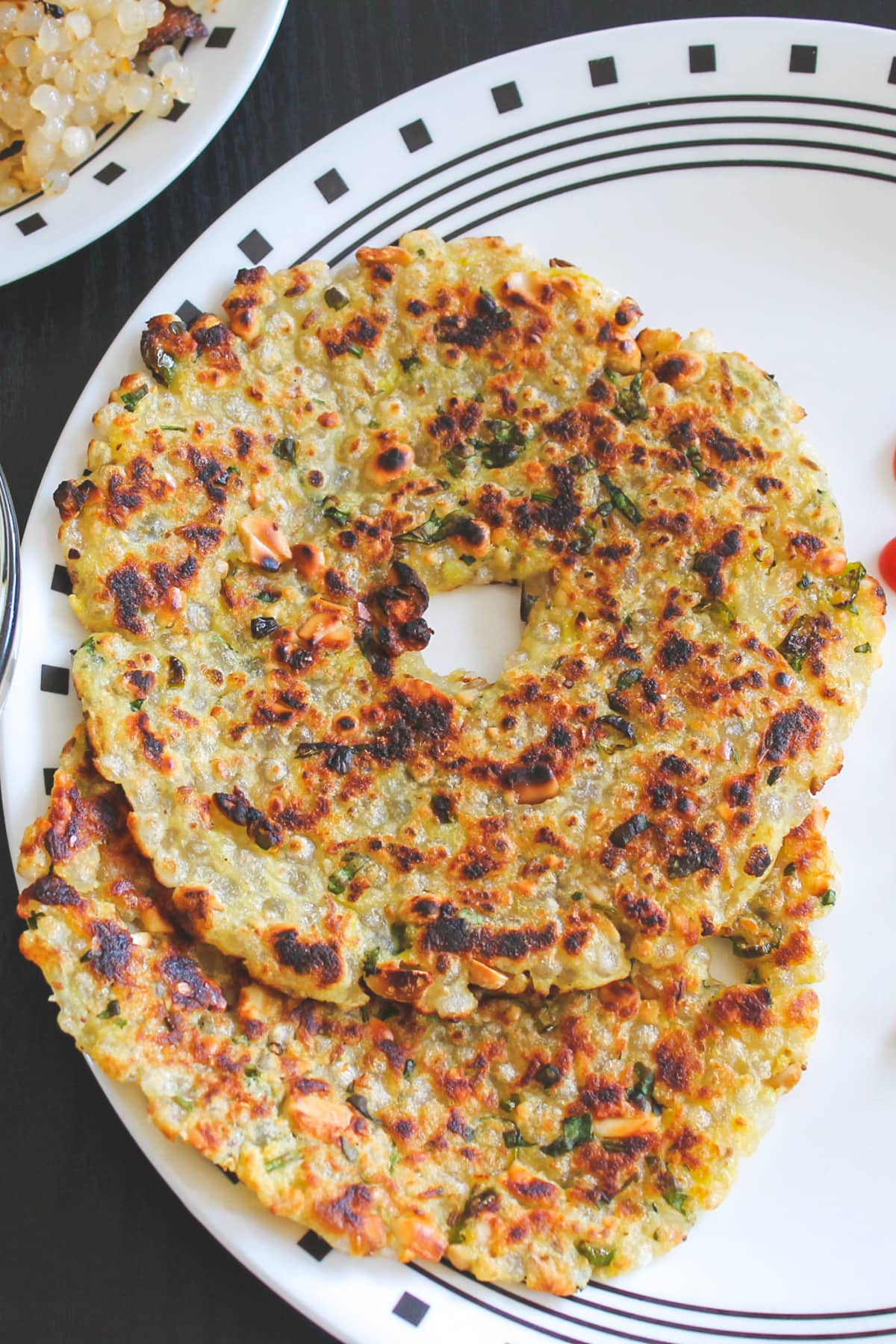 Close up of two thalipeeth in a plate