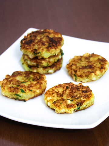 a stack of sabudana tikki with 3 tikkis in single layer in a plate