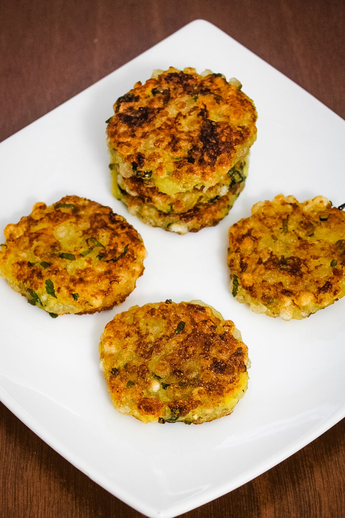 sabudana tikki in a white square plate