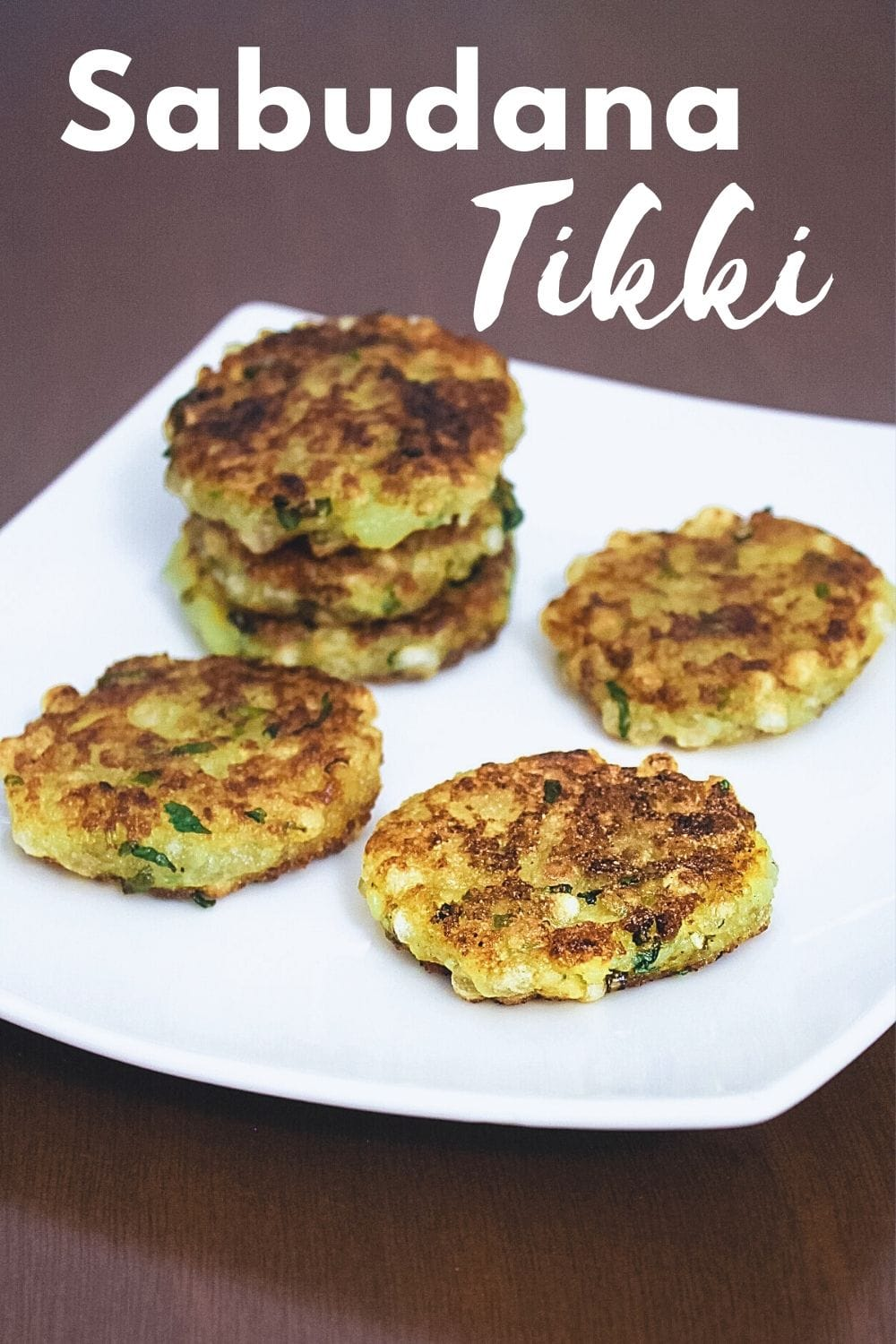 sabudana tikki in a plate with text on top of the image for pinterest