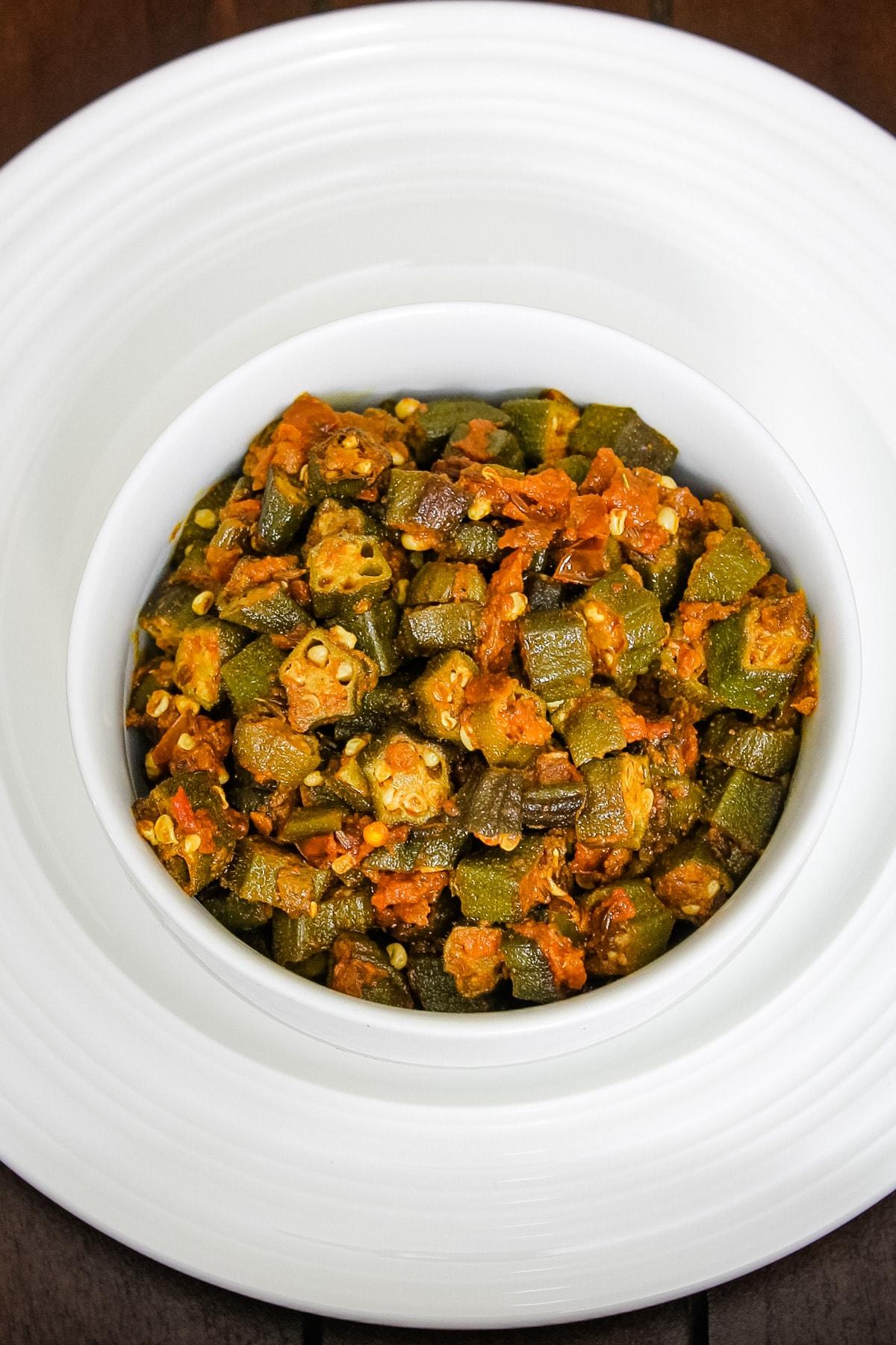 Bhendi chi bhaji served in a white bowl.