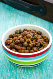 Dry chana in a bowl with wooden tray in the back,