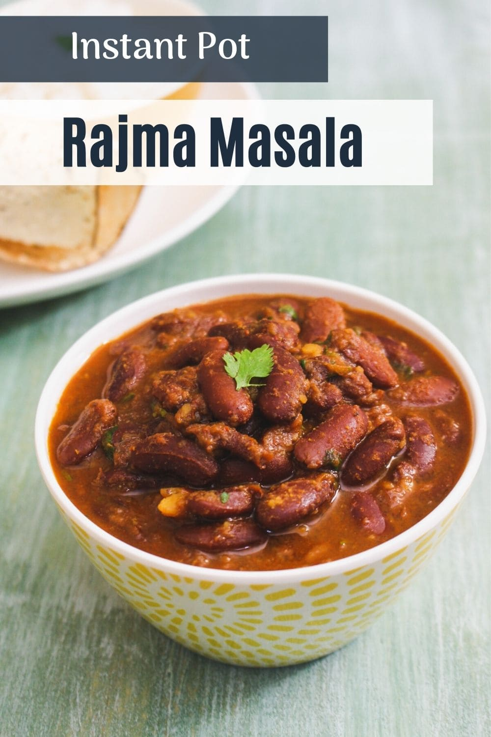 Rajma curry in a bowl with a garnish of cilantro, text on the image for pinterest.