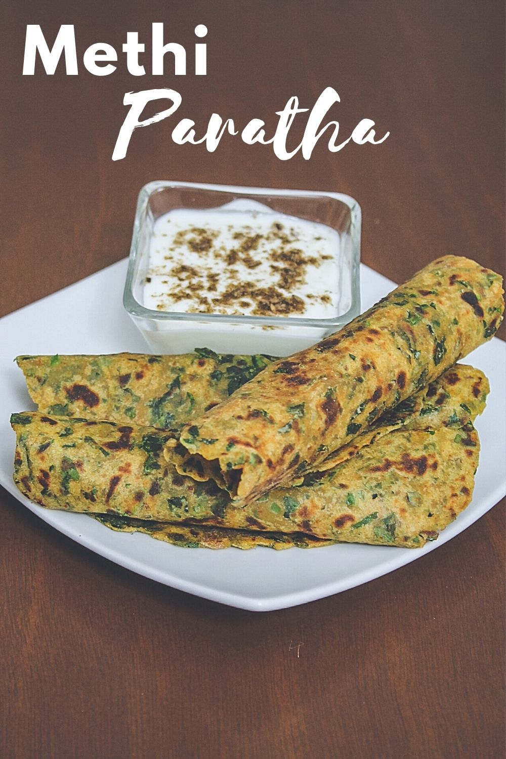 Methi paratha served with yogurt and text on the image for pinterest
