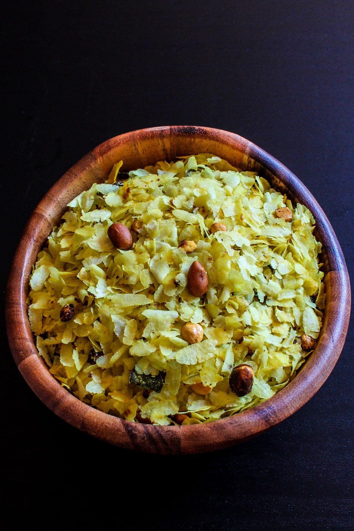 Roasted thin poha chivda in a wooden bowl.