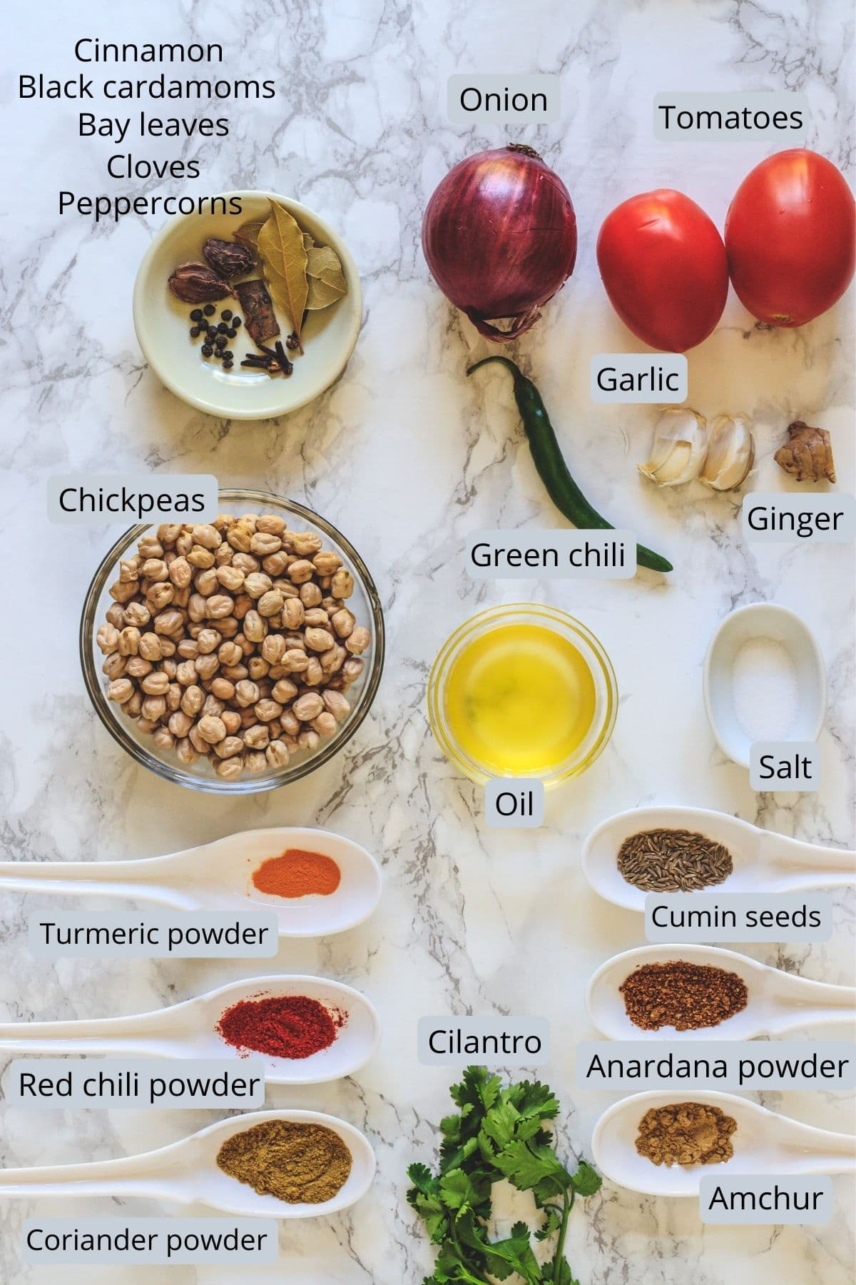 Ingredients used in chole includes chickpeas, onion, tomato, ginger, garlic, chili, oil, salt and spices.