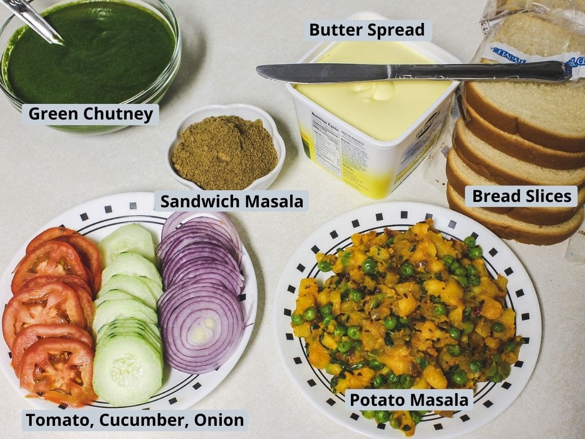 Elements used in toast sandwich includes bread, butter, chutney, sandwich masala, potato masala and veggie slices.