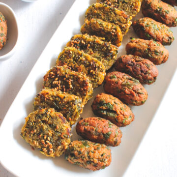Steamed and deep fried methi muthia in a plate.