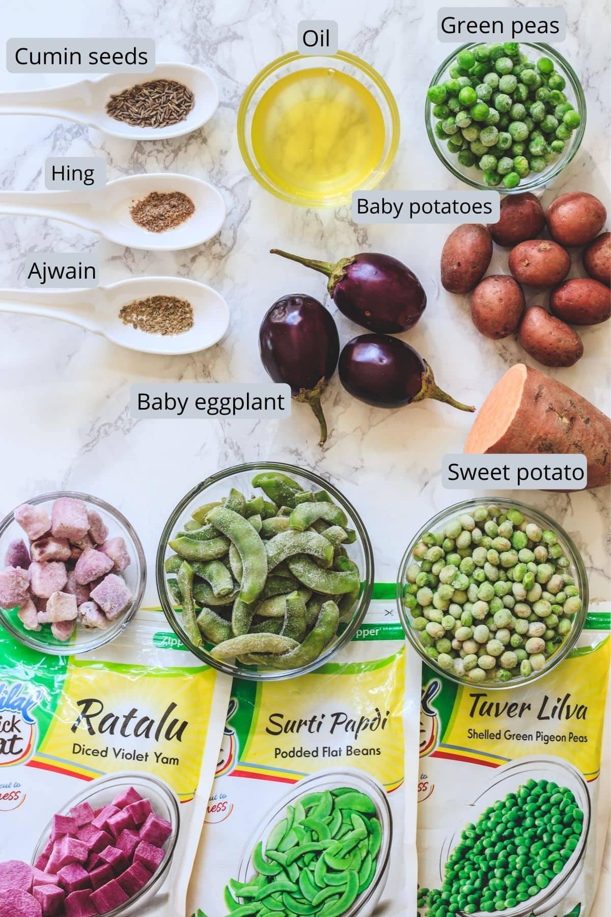 Ingredients used in undhiyu includes oil, cumin, ajwain, hing, peas, potato, sweet potato, eggplant, yam, papdi, lilva.