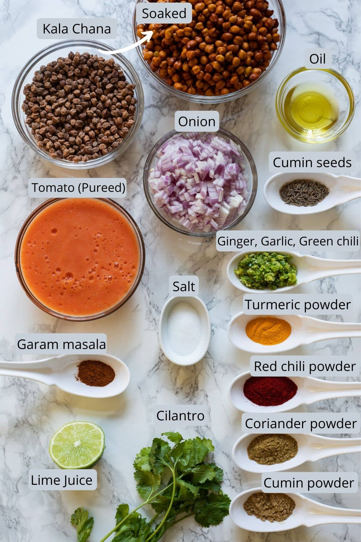 Ingredients used in kala chana includes chana, onion, tomato, ginger, garlic, green chili, spices, oil, salt, cilantro and lime.