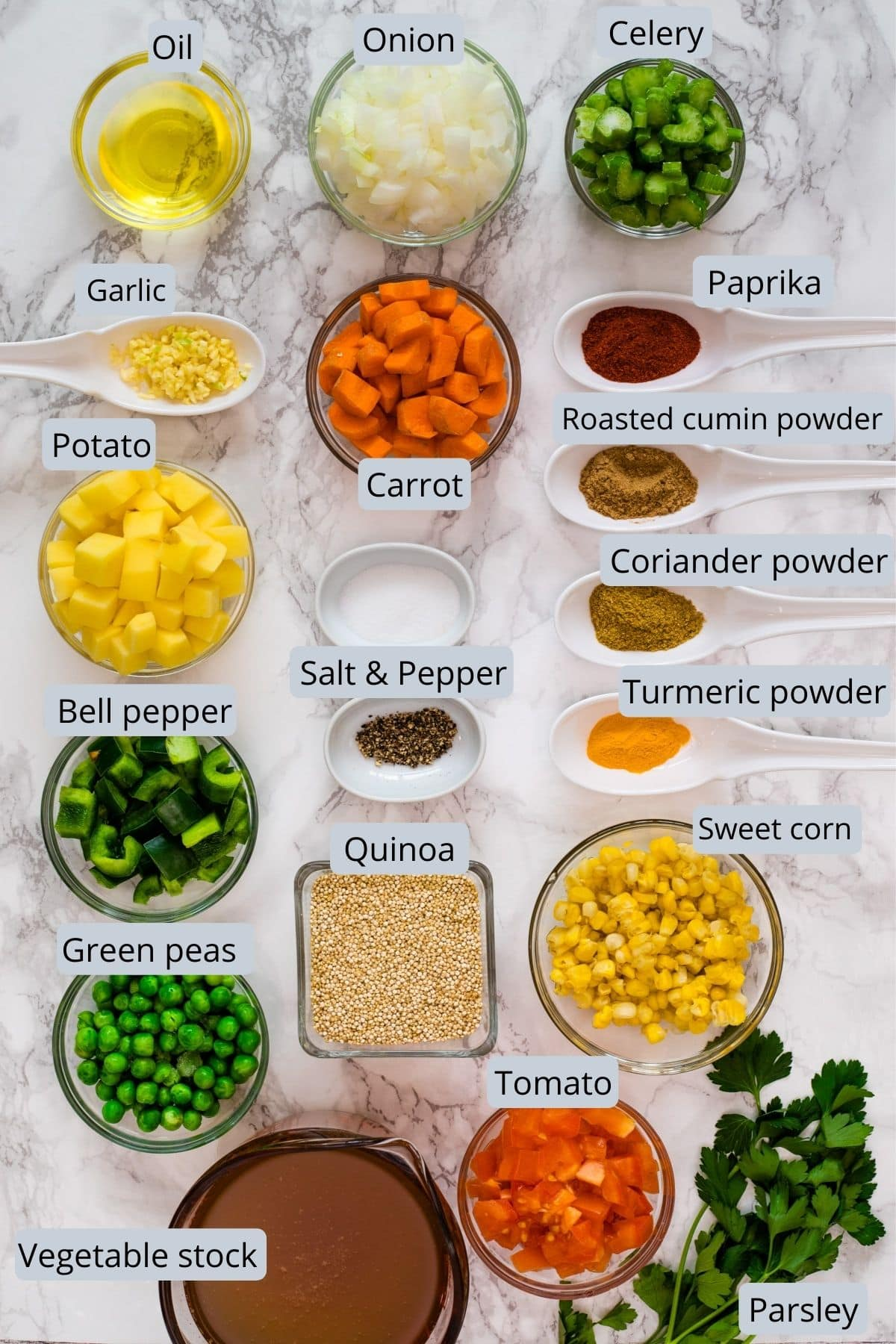 Ingredients used in quinoa vegetable soup includes quinoa, different vegetables, oil, salt, pepper, spices, stock and parsley.