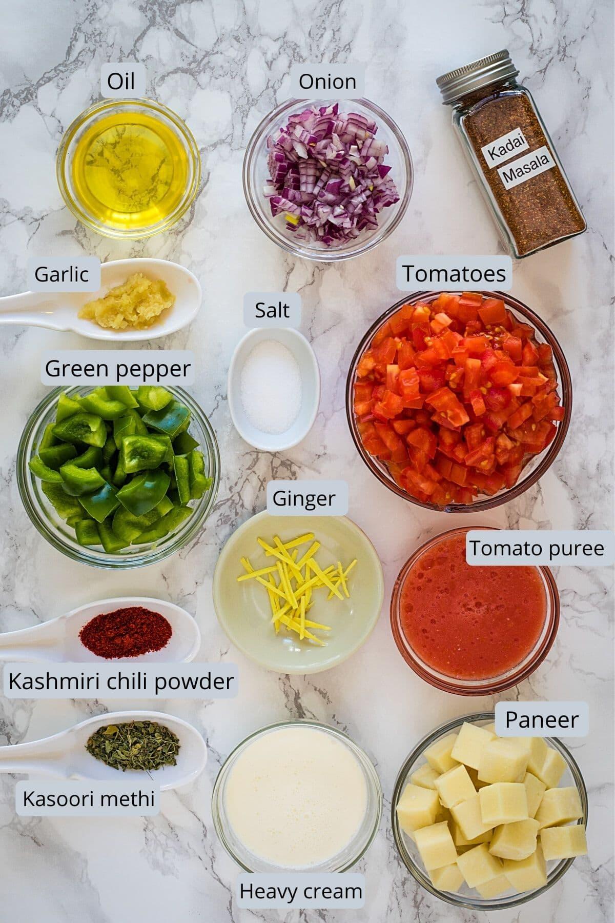 Ingredients used in kadai paneer includes masala, oil, onion, tomato, peppers, ginger, garlic, paneer, cream, salt.