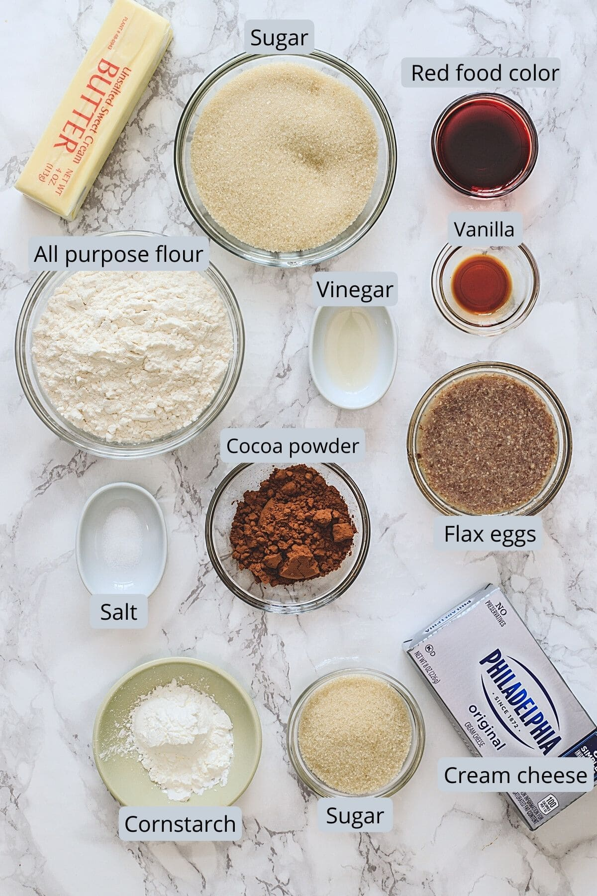 Ingredients used in red velvet brownies includes flour, sugar, cocoa powder, butter, cream cheese, cornstarch, food color, vanilla, vinegar, flax eggs.