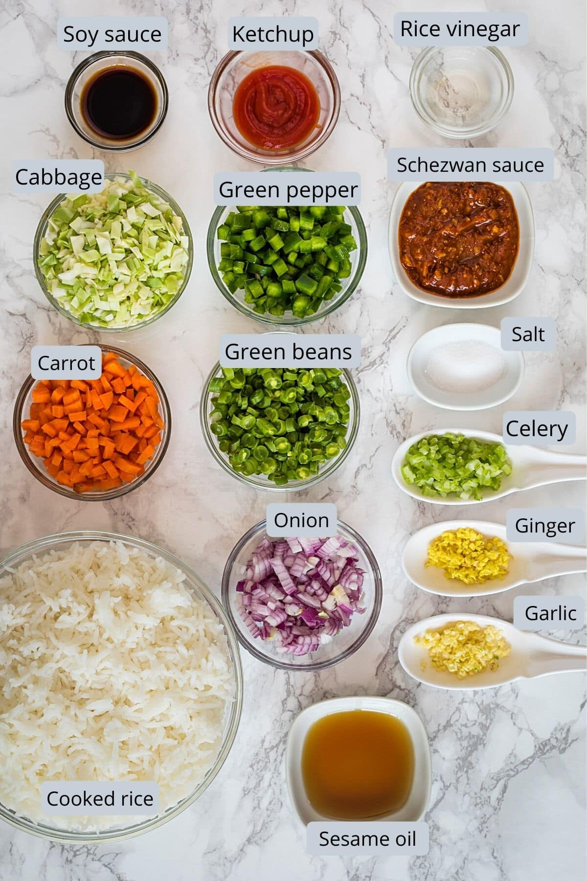 ingredients used in schezwan fried rice includes rice, veggies, oil, salt and chinese sauces.