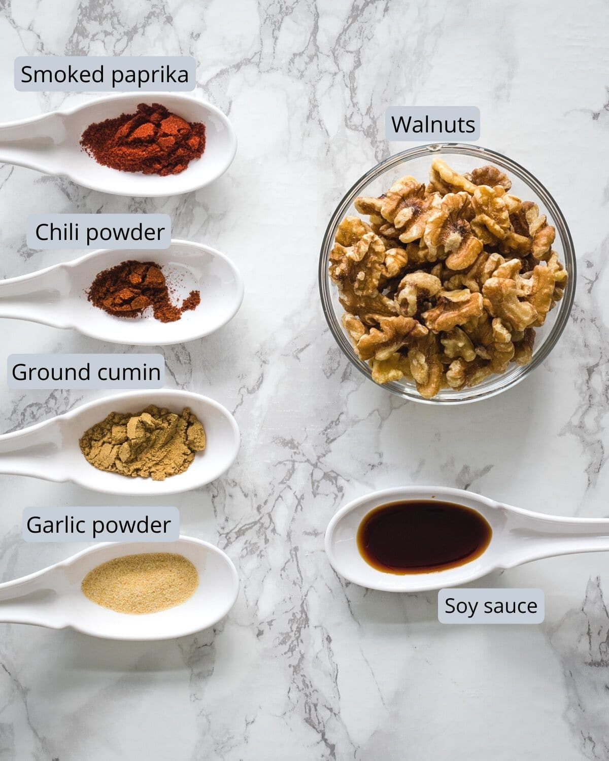 Ingredients used in making walnut meat are removed in individual bowl and spoons.