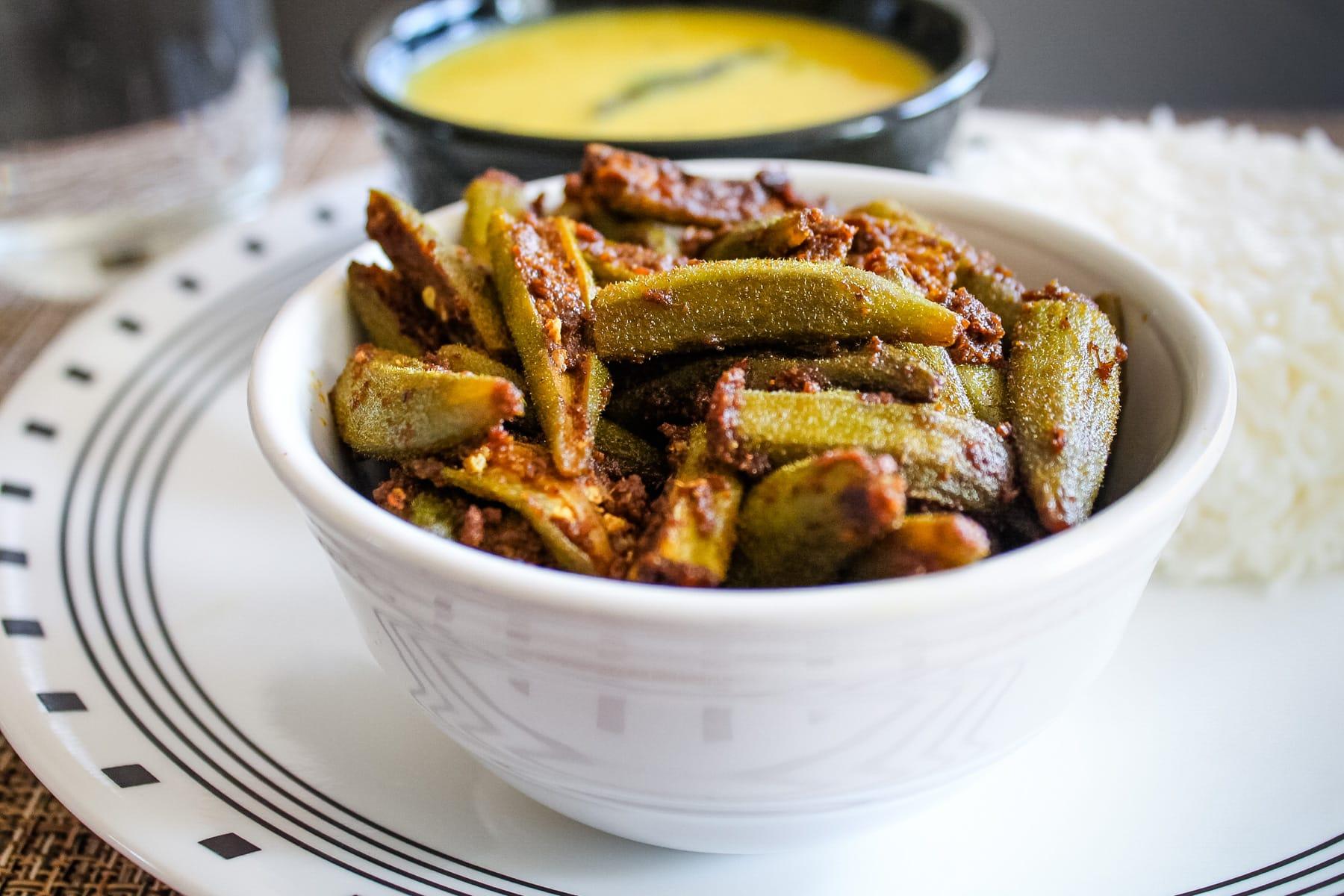 Bhindi masala served in white bowl.