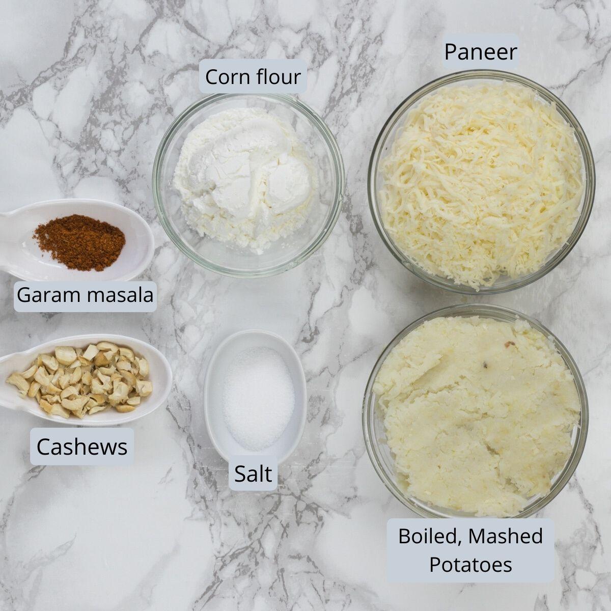 Kofta ingredients in individual bowls and spoons.
