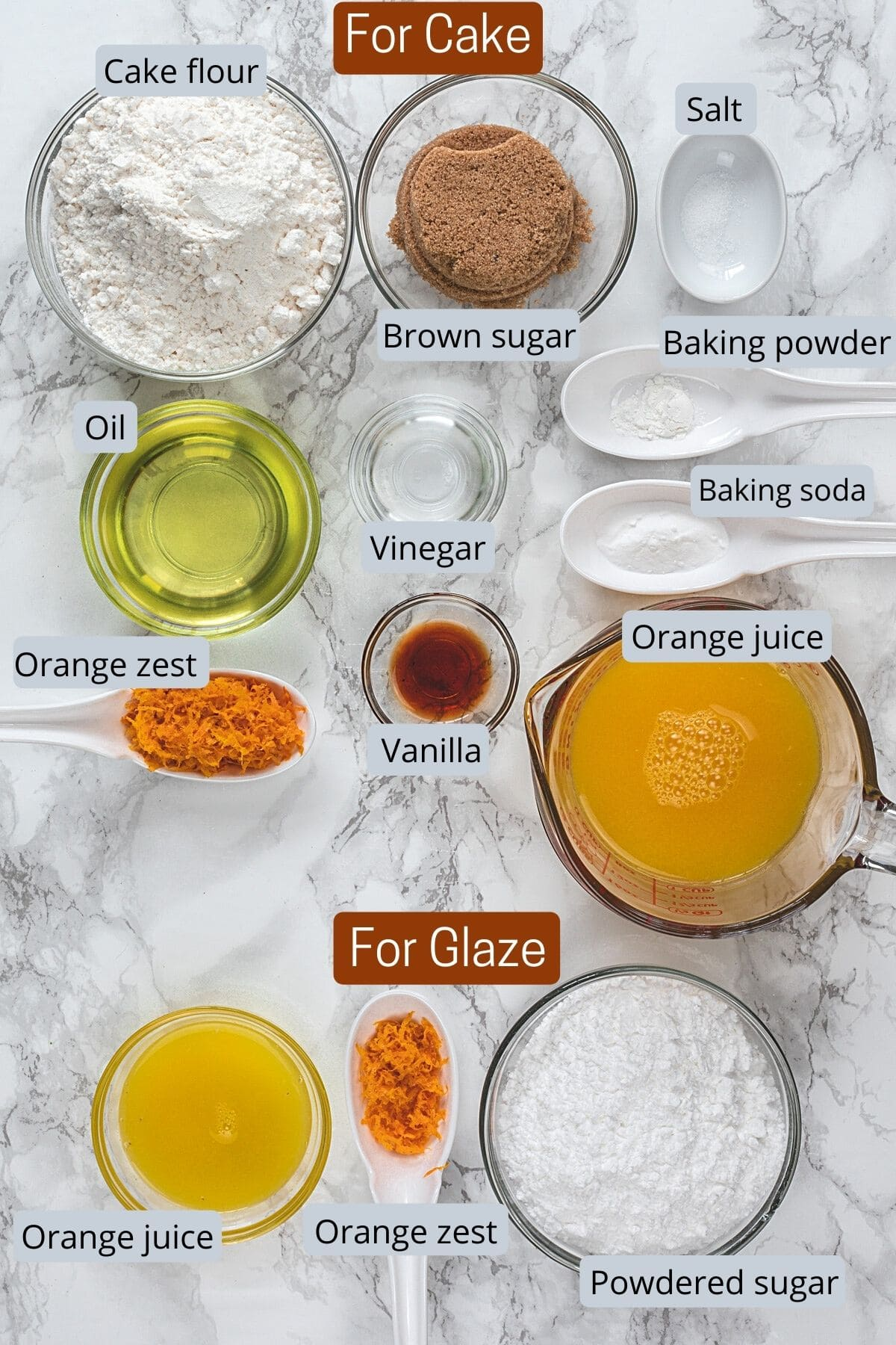 Ingredients for eggless orange cake in individual bowls and spoons.