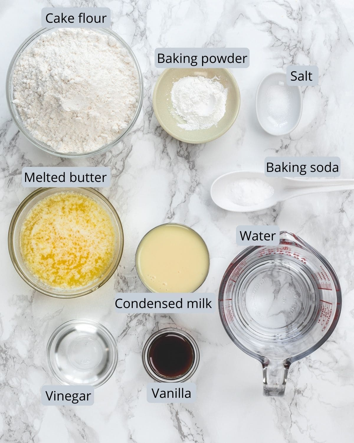 Ingredients use for eggless vanilla cake recipe in individual bowls.