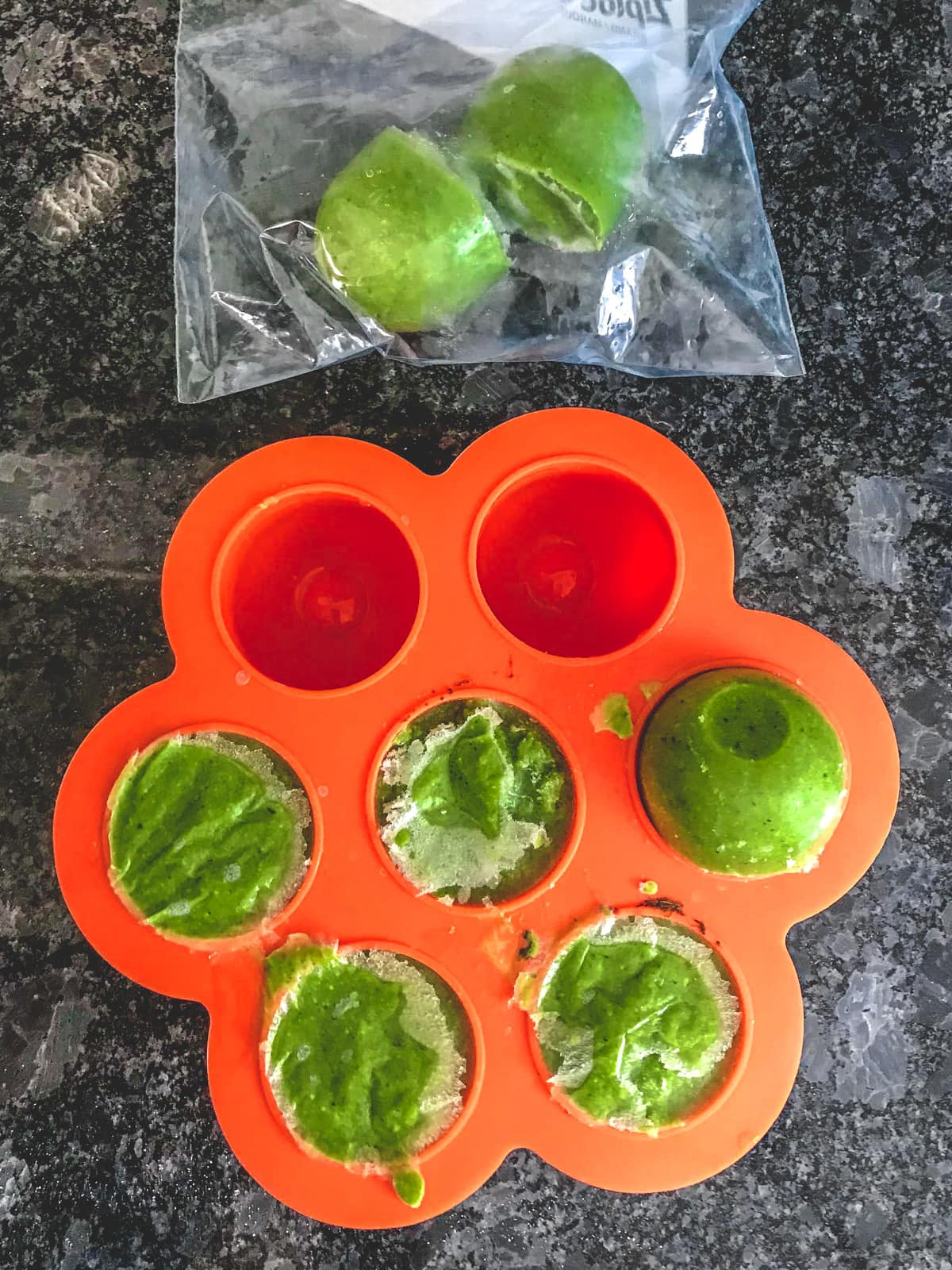 Frozen cilantro chutney in silicone mold and few in the zip lock bag.