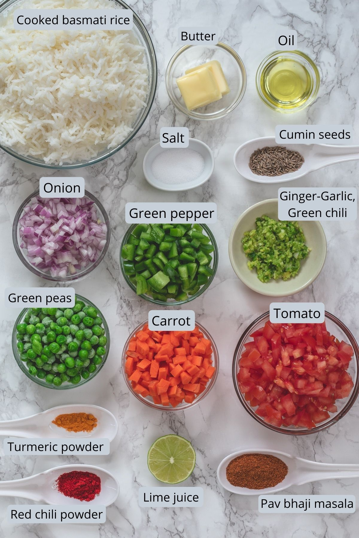 Ingredients used in tawa pulao recipe are in individual bowls and spoons.